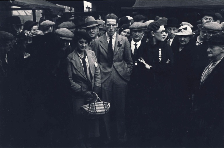 (10) Press Image l Mass Observation l This is Your Photo l Humphrey Spender, Crowd at market, 1937